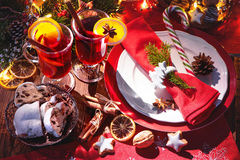 Red mulled wine with cinnamon sticks and orange slices Stock Photos