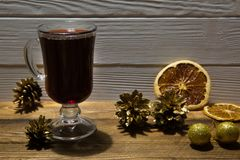 Red mulled wine and dried sicilian orange slices. Golden Christmas decoration. stock photos