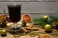 Red mulled wine drinks with dried red oranges slices, sparkling royalty free stock photography