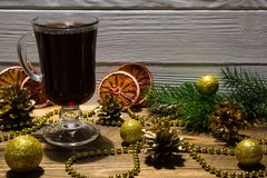 Red mulled wine drinks with dried red oranges slices, sparkling stock photo