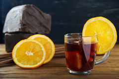 Red mulled wine with fruits and cinnamon Royalty Free Stock Photos