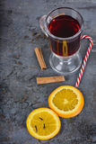 Red mulled wine, spices and candy cane Royalty Free Stock Image