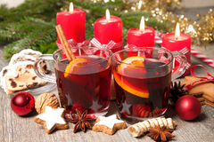 Red mulled wine on table with burning candles Royalty Free Stock Photos
