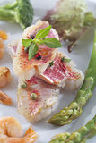 Red mullet fillets with garnish Royalty Free Stock Image
