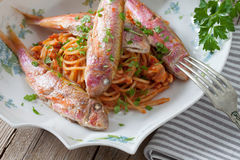 Red Mullet Fish On Spaghetti Stock Photography