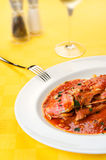 Red Mullet seafood tomato wine, salt, pepper. Red Mullets seafood italian traditional gourmet recipe with tomato, garlic, olive oil with wine glass, salt and Stock Image
