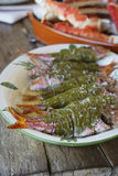 Red mullet wrapped in vine leaves with coarse salt Stock Image