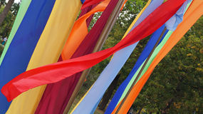 Red and multicolored fabrics Stock Images