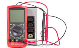 Red multimeter and UPS (uninterruptible power supply) Stock Images