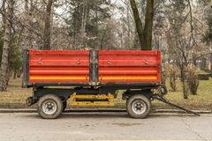 Red municipality trailer ready for park maintenance . Royalty Free Stock Photography