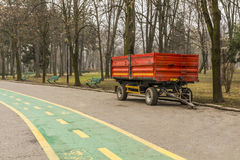 Red municipality trailer ready for park maintenance . Stock Images