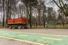 Red municipality trailer ready for spring works in the park Stock Image