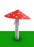 Red mushroom. From paper on the grass Stock Image