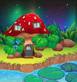 A red mushroom house near the river with waterlilies Stock Photos