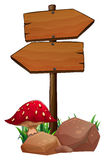 A red mushroom near the wooden arrowboards Royalty Free Stock Image