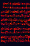 Red musical notes on black Stock Images
