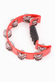 Red musical tambourine. On white background Stock Image
