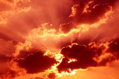 Red mystical sky. With beam of light coming out across clouds Stock Image