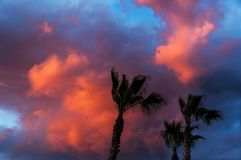 Red mystical sky. Dramatic colorful cumulus clouds at sunset royalty free stock photo
