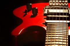 Red'n black. Close-up of a red guitar on black background Stock Photography