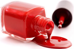 Red Nail Polish. In open flagon and drop beside Royalty Free Stock Photo