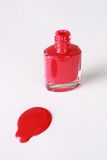 Red Nail Polish. Red finger nail polish isolated against a white background Royalty Free Stock Image