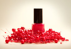 Red nail polish. Cosmetics - Red nail polish and red pearls Royalty Free Stock Photo