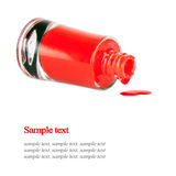 Red nail polish bottle. Isolated on white Royalty Free Stock Photo