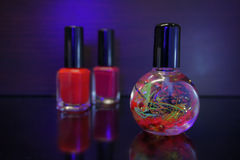 Red nail polish bottle and cuticle oil for manicure on black. Manicure tool and red nail polish bottle with cuticle oil  on black  background isolend Stock Images