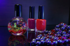 Red nail polish bottle and cuticle oil for manicure. Manicure tool and red nail polish bottle with cuticle oil  on black  background isolend Stock Photography