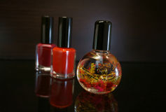 Red nail polish bottle and cuticle oil for manicure. Manicure tool and red nail polish bottle with cuticle oil  on black  background isolend Stock Photos