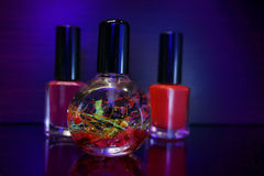 Red nail polish bottle and cuticle oil for manicure. Manicure tool and red nail polish bottle with cuticle oil  on black  background isolend Royalty Free Stock Images