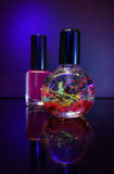 Red nail polish bottle and cuticle oil for manicure. Manicure tool and red nail polish bottle with cuticle oil  on black  background isolend Royalty Free Stock Image