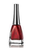Red nail polish bottle isolated on white Stock Photography