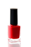 Red nail polish bottle over white Royalty Free Stock Image