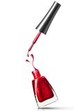 Red nail polish bottle with splash royalty free stock photo