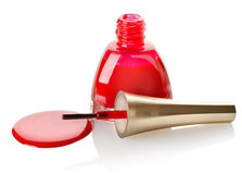 Red nail polish and brush Royalty Free Stock Photo