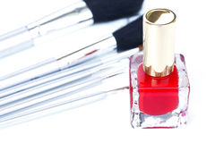 Red nail polish and brushes Stock Photos