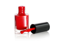 Red nail polish with drop. On a white background Royalty Free Stock Images