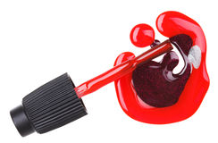 Red nail polish (enamel) drops with brush Royalty Free Stock Images