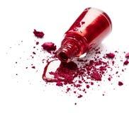 Red nail polish and eye shadow Stock Photo