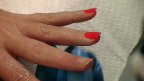 Red nail polish on female nails. stock video
