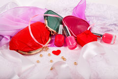 Red nail polish and female red purse Royalty Free Stock Images