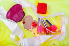 Red nail polish and female red purse Stock Images