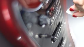 Girl playing on a red electric guitar stock footage