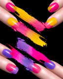 Red Nail Polish and Mineral Colorful Eye Shadow Royalty Free Stock Image