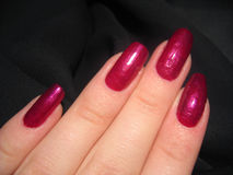 Red nails. Hand with nice nails Stock Photography