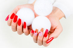 Red nails decorated for your fantastic Christmas Royalty Free Stock Photos