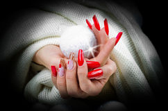 Red nails decorated for your fantastic Christmas Stock Photo
