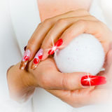 Red nails decorated for your fantastic Christmas Stock Images